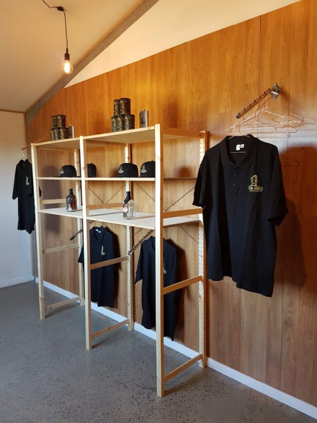 Image-of-Illegal-Tender-Rum-Co.-Merch-product-wall